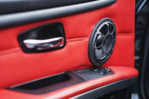 car speaker on red leather