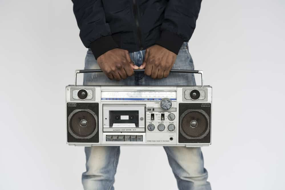 listening to music in boombox